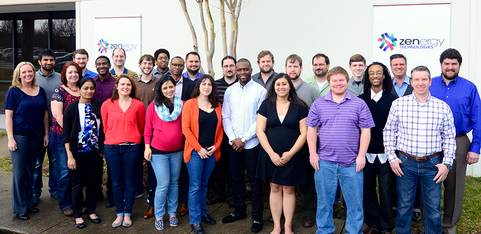Picture of employees taken in-front of Zenergy Technologies, software testing facility